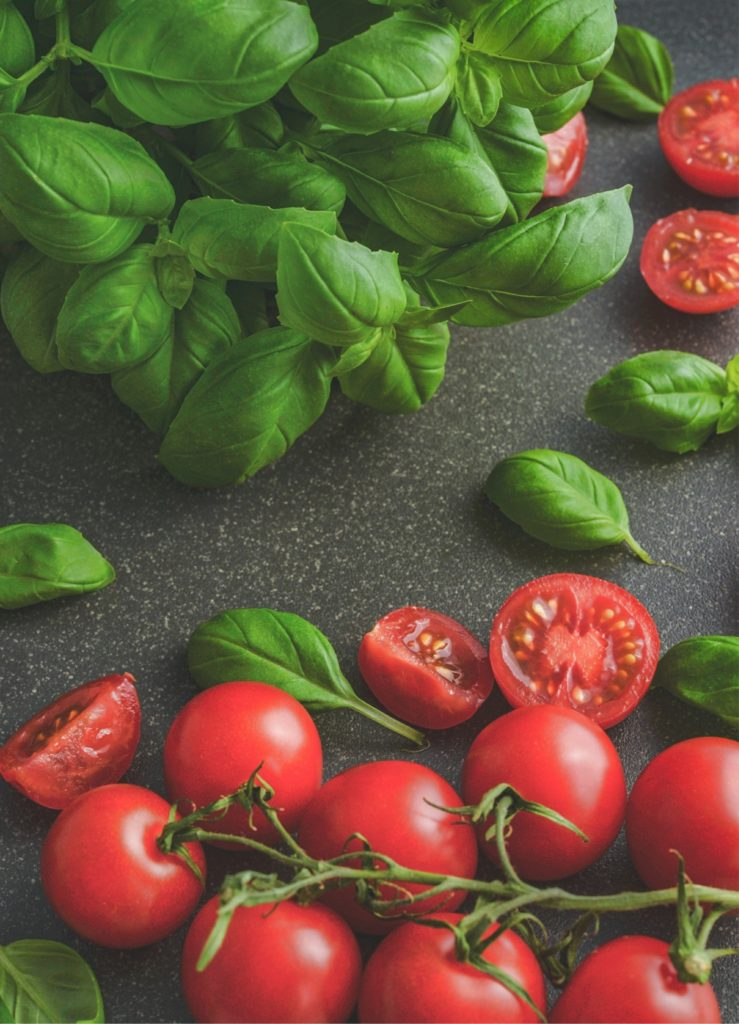 This image has an empty alt attribute; its file name is basil-and-tomatoes-739x1024.jpg